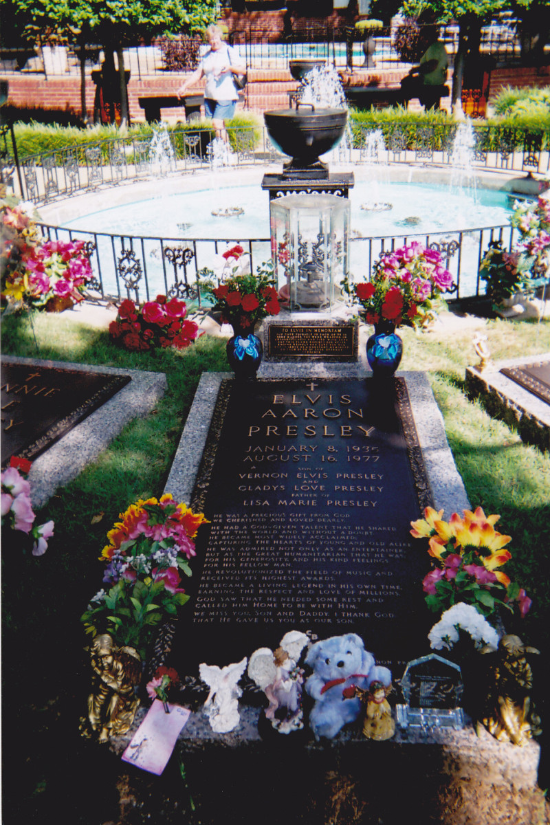 Visiting Elvis' grave site on the Graceland grounds. It is a very moving place.