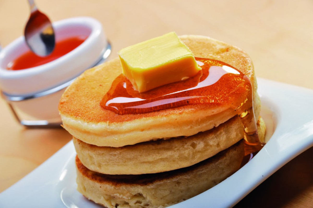 Pancake served with butter and maple syrup on Air Asia AK flights