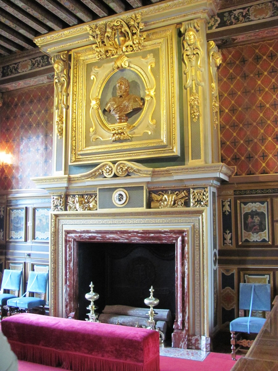 The Neo-Renaissance style fireplace is gilded in gold and features a bust of King Henry IV.