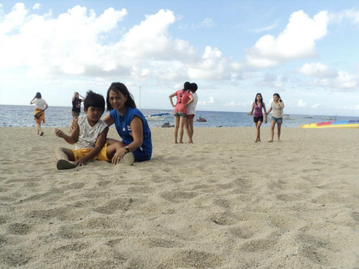 Children Sitting on the White (But Not as White  as Borcay) Sand