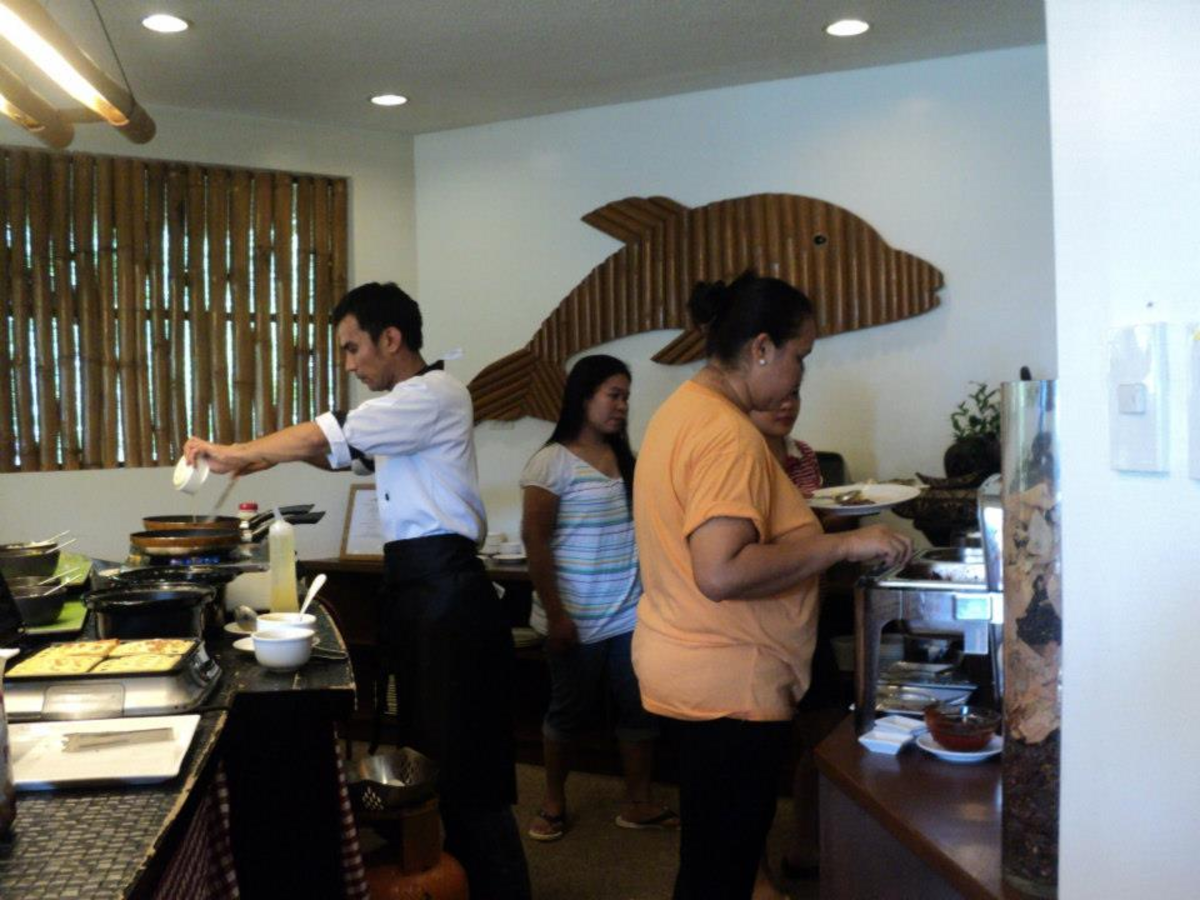 A Cook Making Omelets During Breakfast Buffet at Acauverde