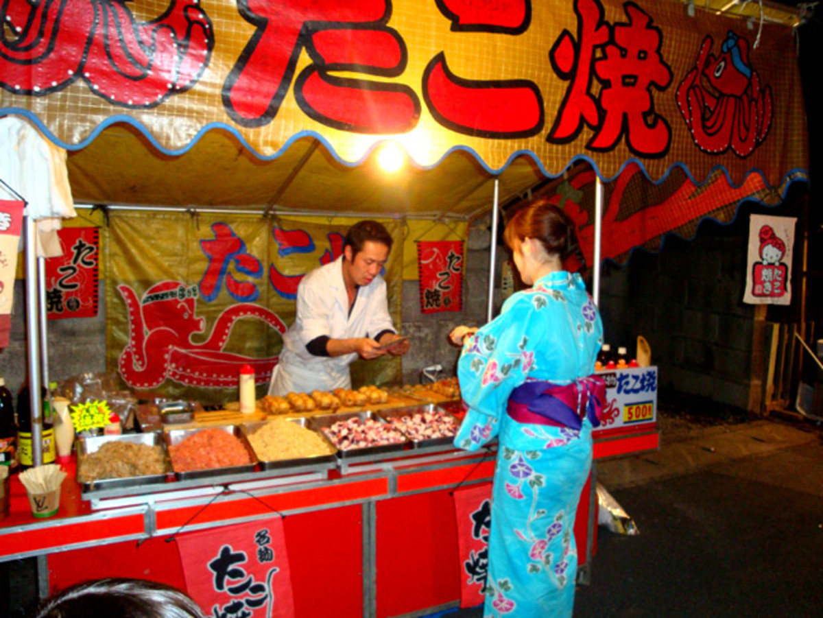 Buying delicious takoyaki at a festival