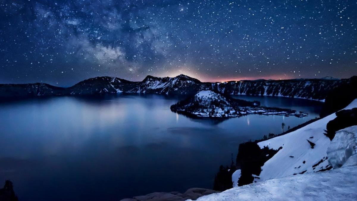 Crater Lake at night reflecting a star-lit sky