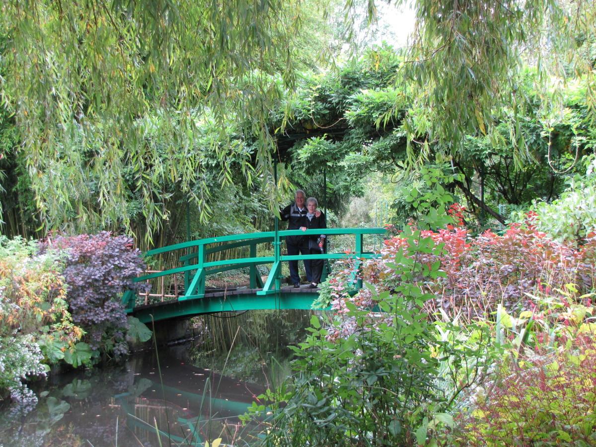 Wisteria covered Japanese bridge