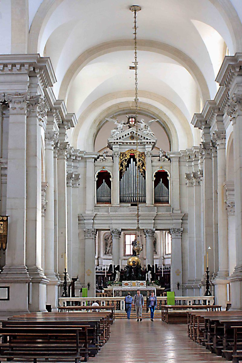 The interior of Palladio's Church which features several major art works by the artist Tintoretto, a 16th century altar sculpture, and carved wooden choir stalls of the same age