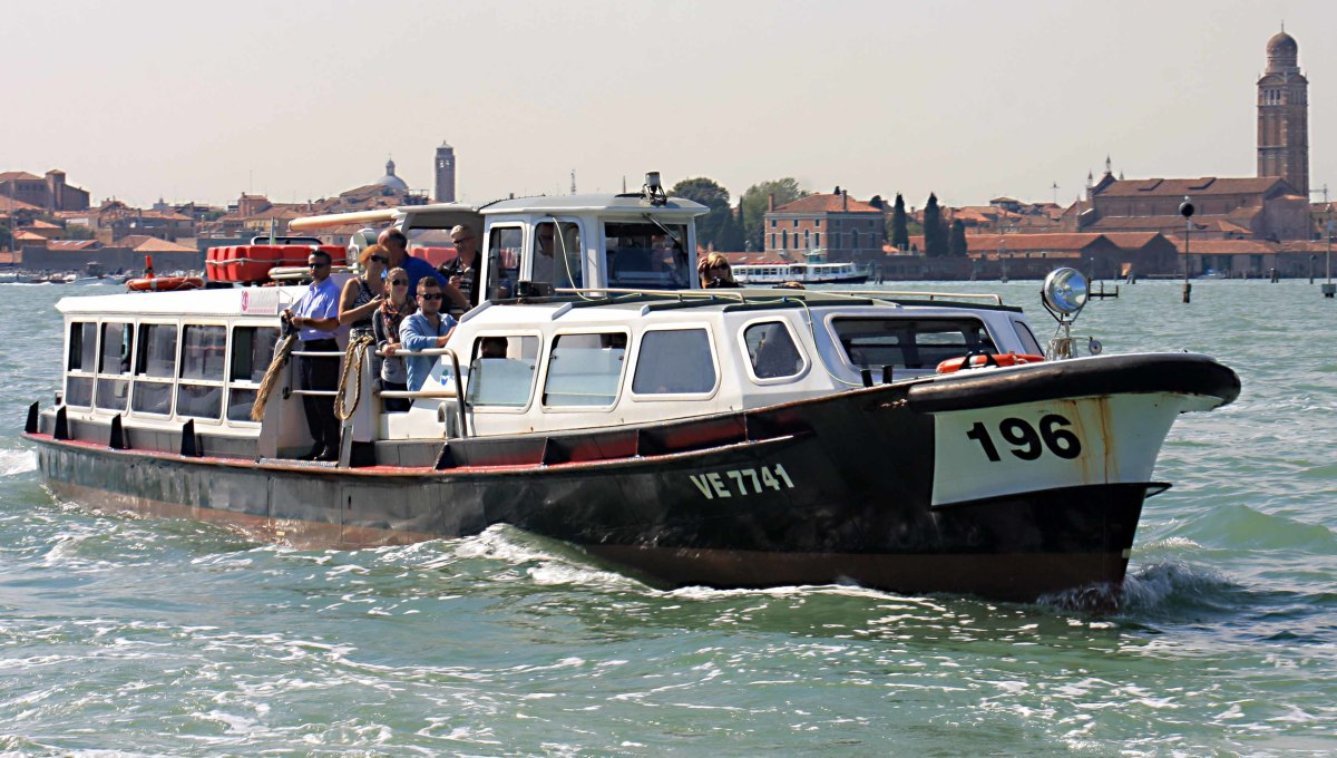 A vaporetto water bus, carrying passengers between Venice and the island of San Michele