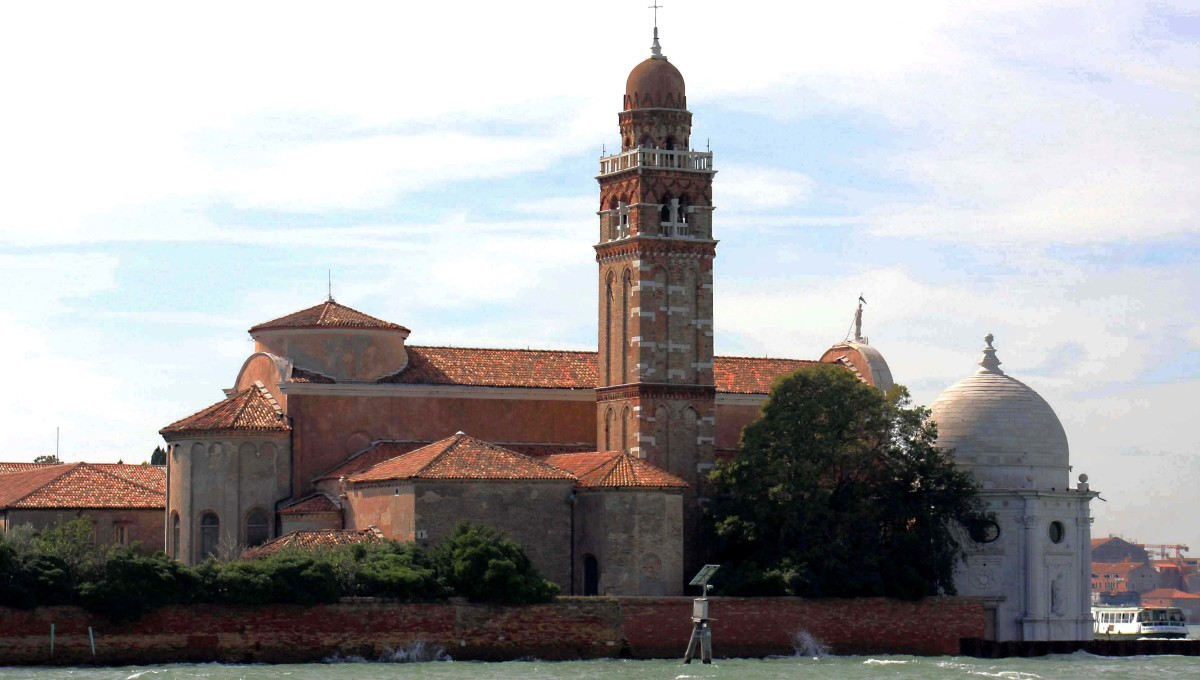 San Michele, as seen from the island of Murano, with a vaporetto - and Venice - on the extreme right. The tantalisaing sight of historic buildings across the lagoon should be enough to encourage anyone to set out and explore these other islands