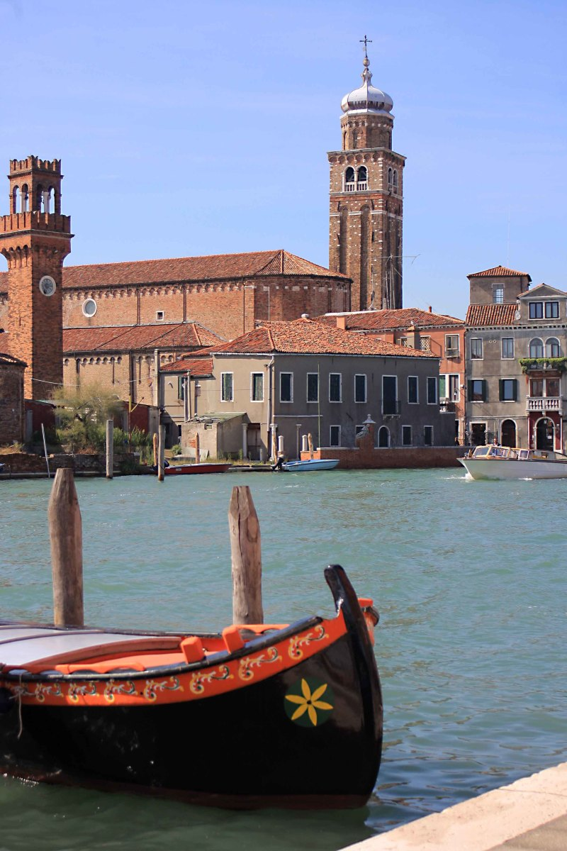 One of the wide waterways of Murano. The tall bell tower right of centre is part of San Pietro Martire, an early 16th century church