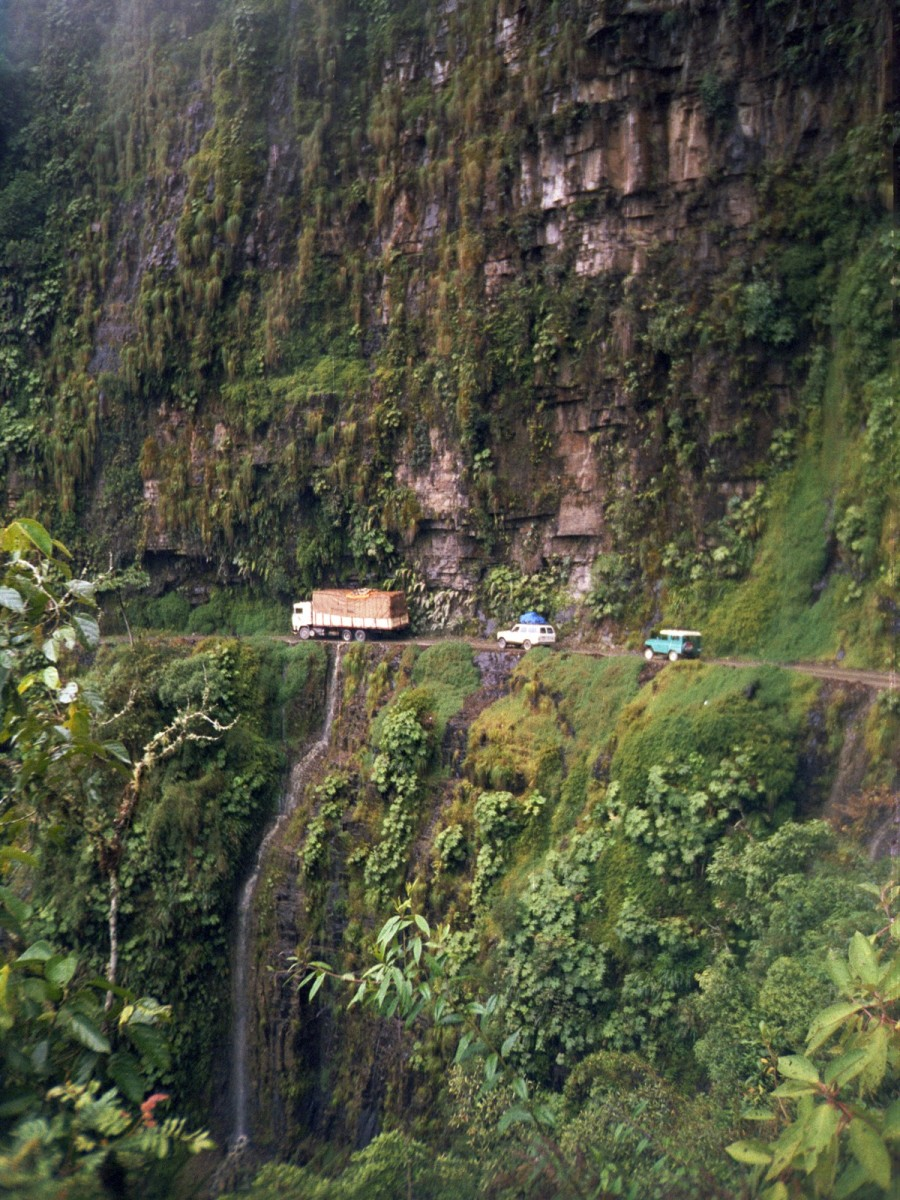 A procession of vehicles making their way along Bolivia's North Yungas Road.