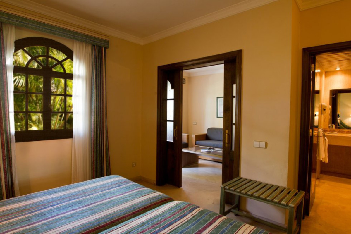 The junior suite bedroom, with views through to the lounge and bathroom