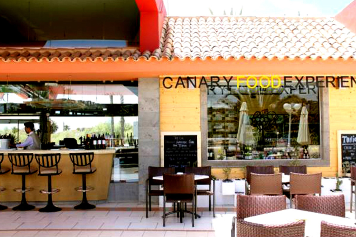 The Reception bar on the left and the Canary Food Experience shop on the right