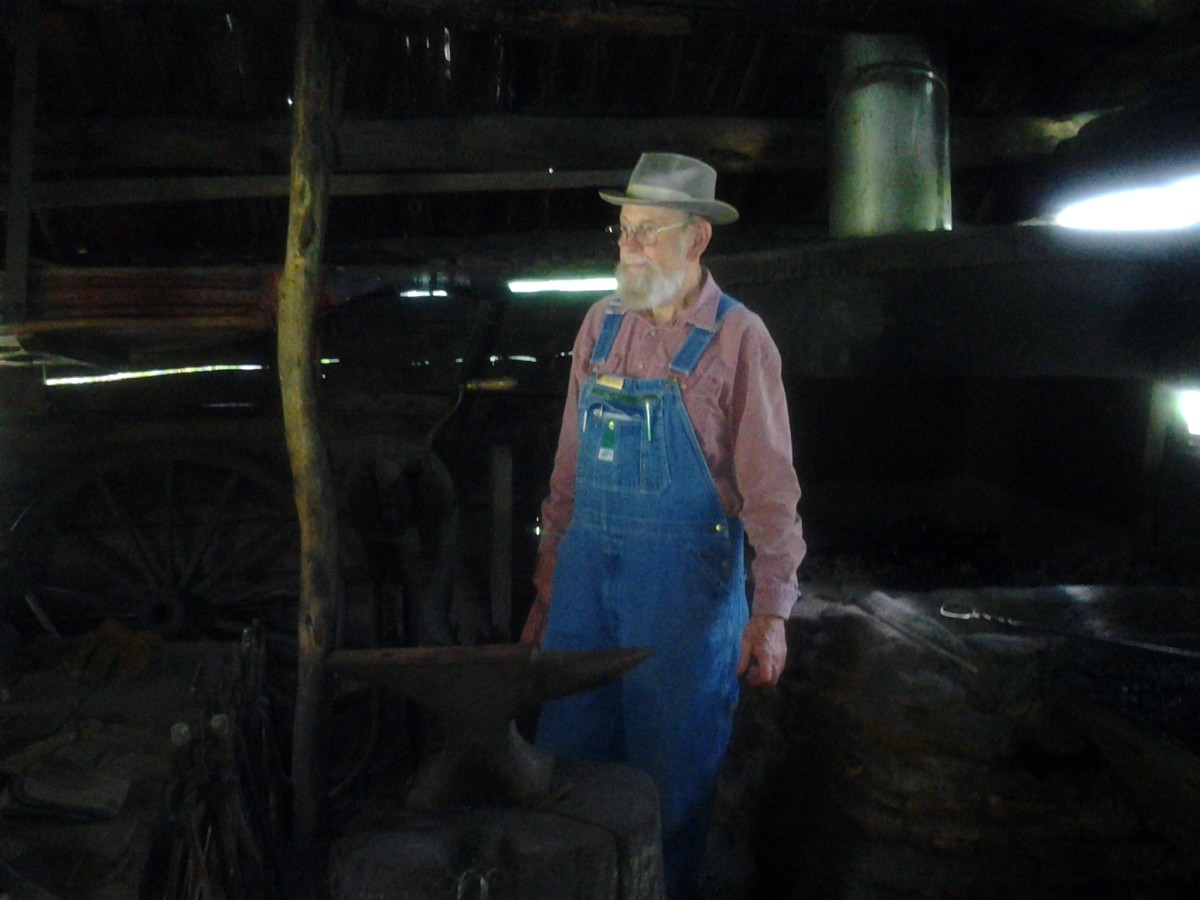 Blacksmith Will Foster demonstrates his skills at Mabry Mill.  Mr. Foster is a volunteer.