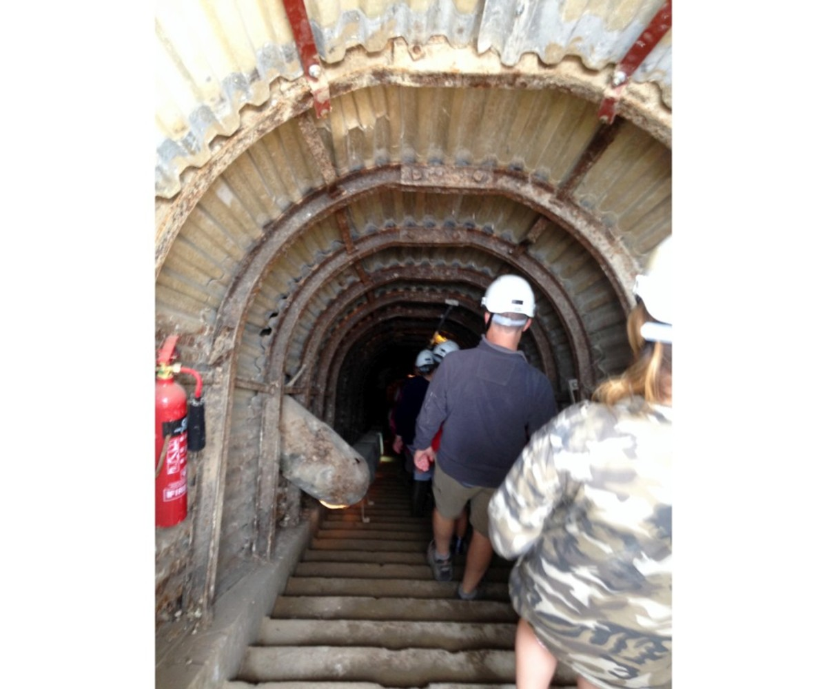 The first set of steps leading down into the tunnels. Note the hard hats worn by everyone.