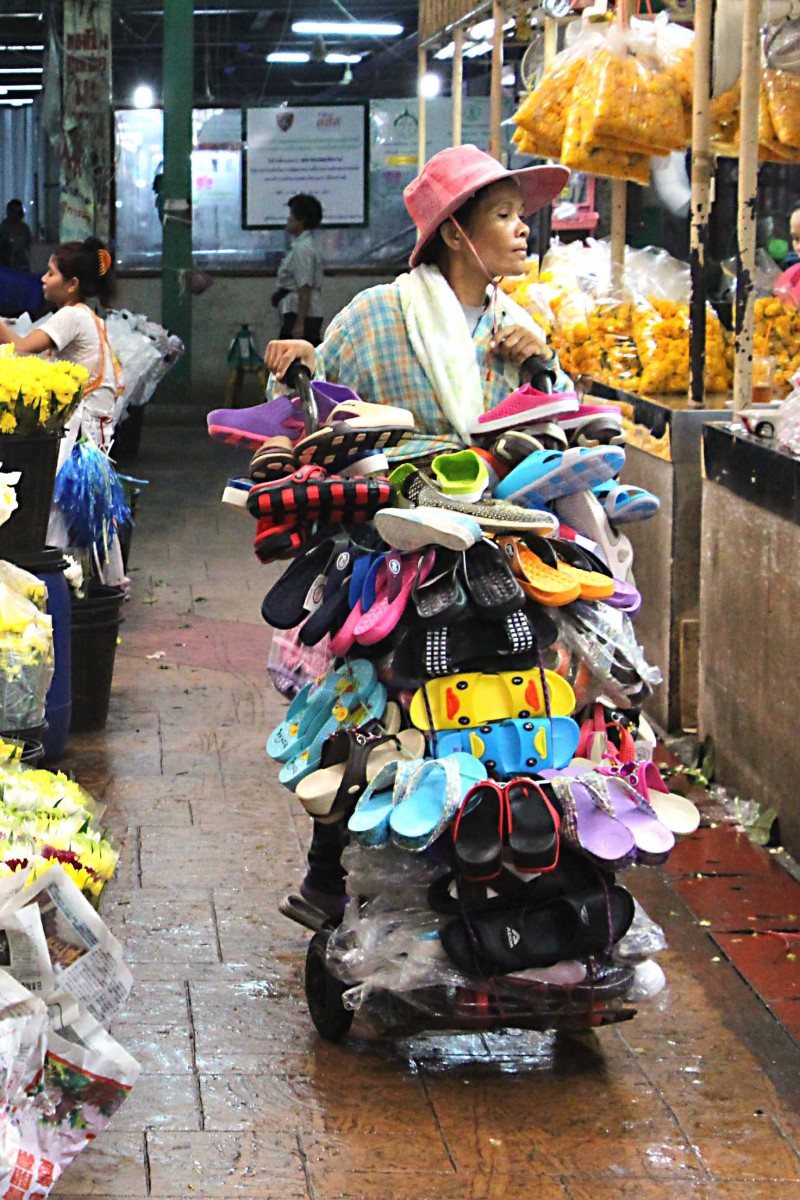 A market trader wheels away about as many shoes as some shoe shops stock!