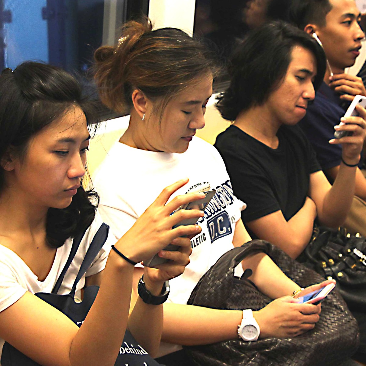 Like everyone in the modern world, commuting Thais are addicted to texting, music playing and gaming on their teeny-weeny cellphone computers. And like everyone else, that often takes precedence over actual social contact