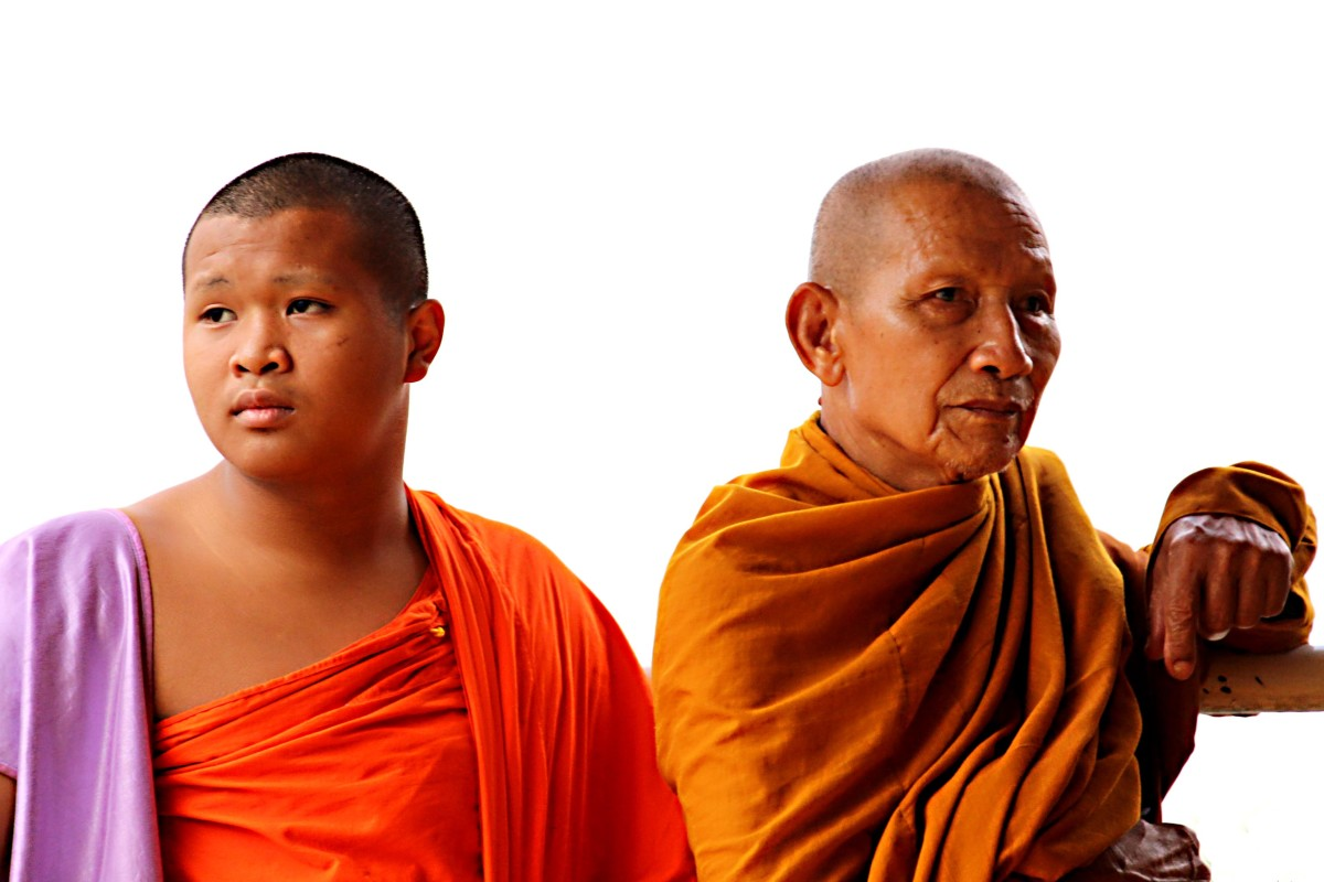 Buddhist monks in their orange robes are a common sight in Bangkok