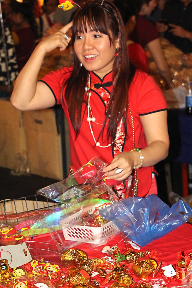 If there is one after-nightfall event to be experienced it must be Chinatown during the Chinese New Year. Here a street trader on the most packed street I have ever walked along, wears 'lucky' red. Many many people on the street wore red that night.