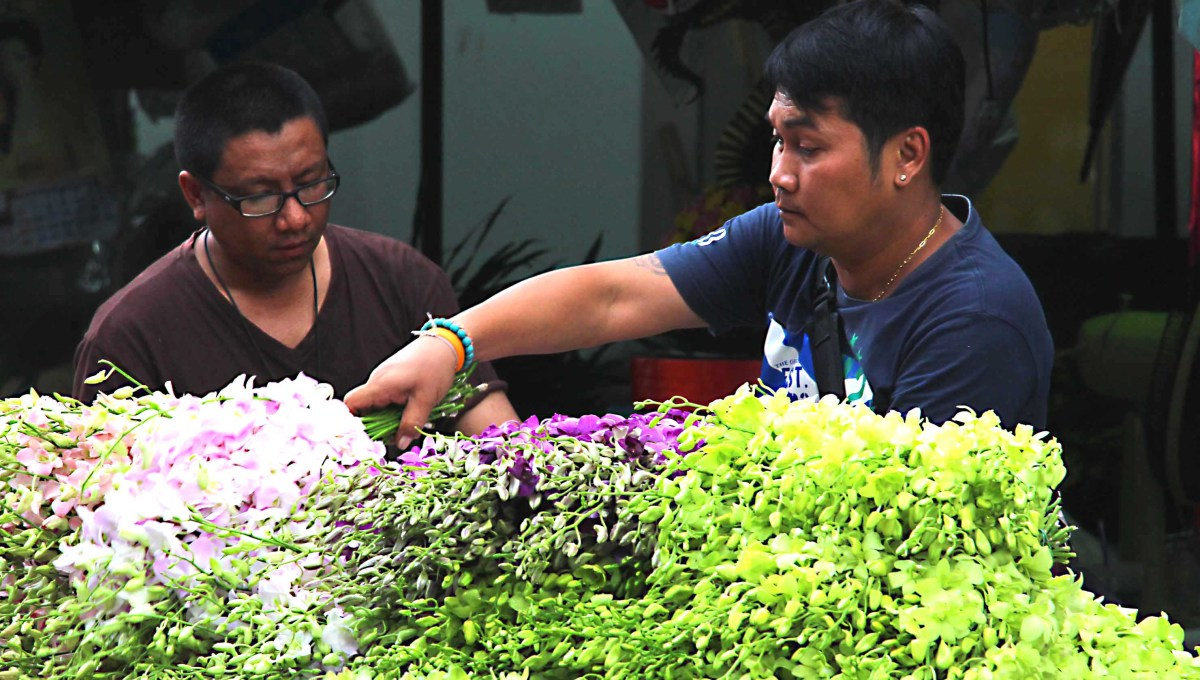 Flower sellers at Pak Klong Talad Market