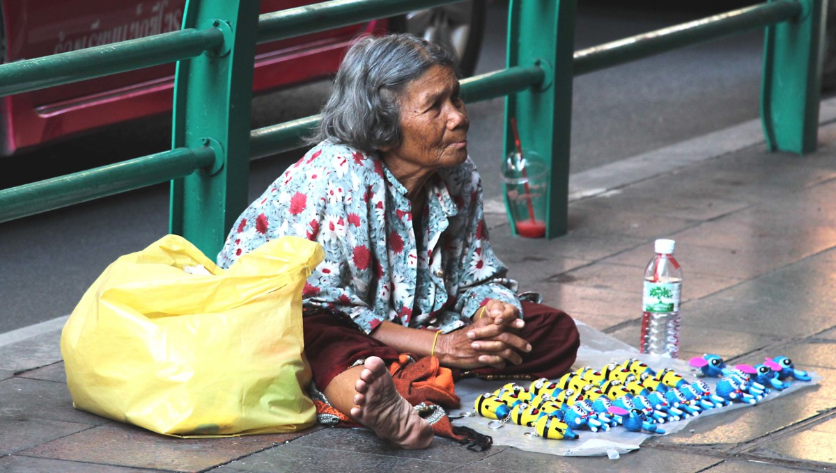 Some will do what they can to earn a few coins on the street. This lady was selling key rings for 30 baht (about 60p - 85c) - rings she'd probably bought in a local market