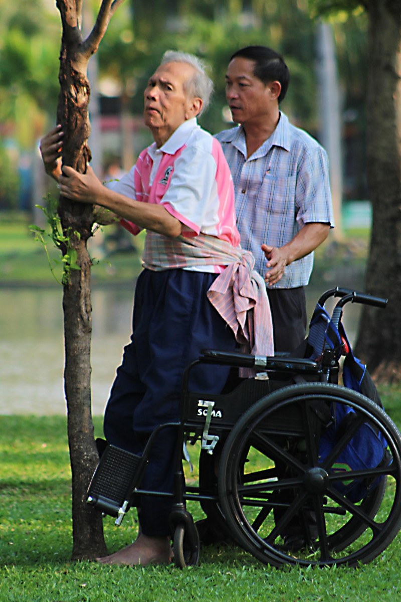 For a long time I watched as this disabled, elderly gentleman was helped to exercise by members of his family in Chatuchak Park. Their devotion to helping him stand and walk was considerable and touching