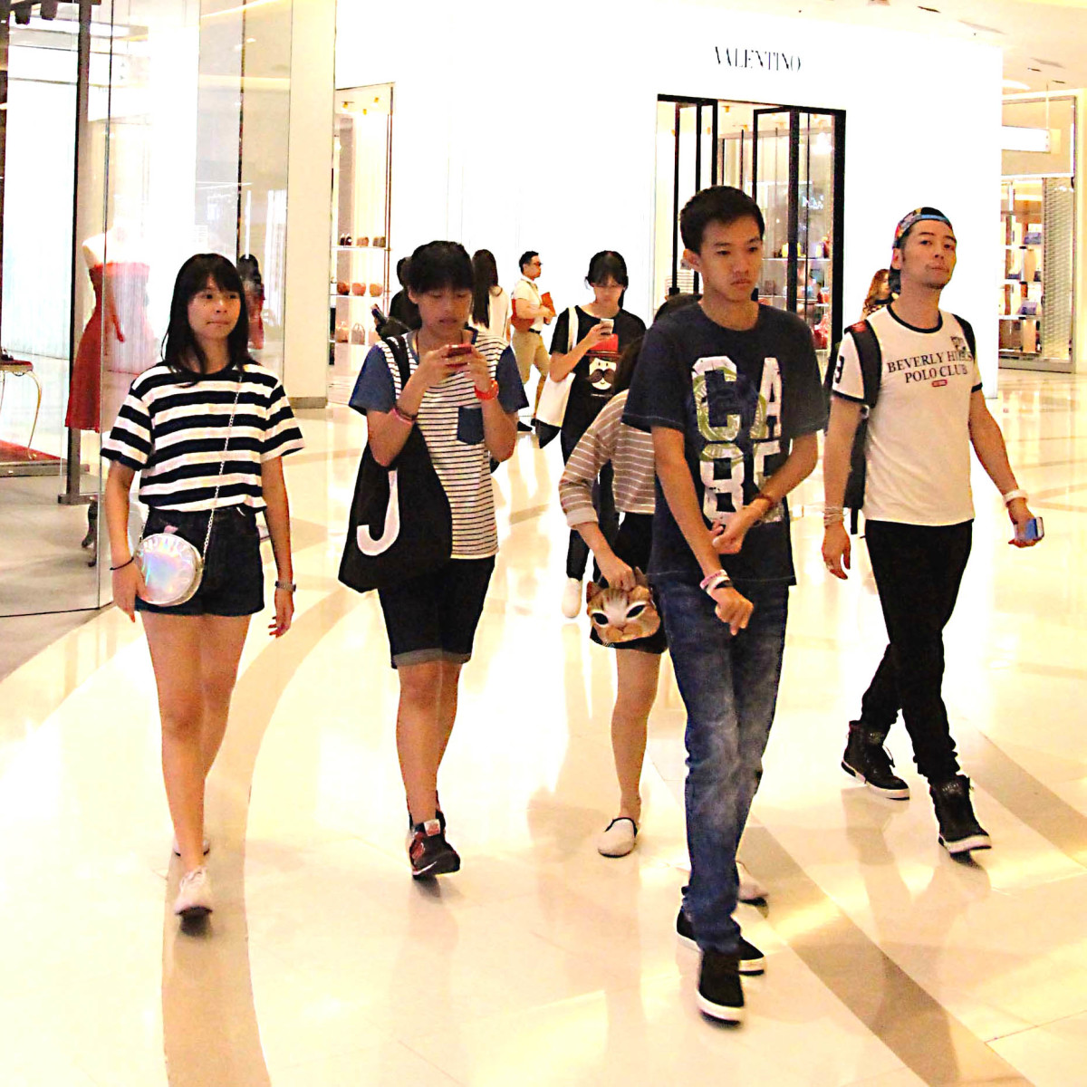 Young shoppers in one of the ultra modern fashionable malls of Bangkok