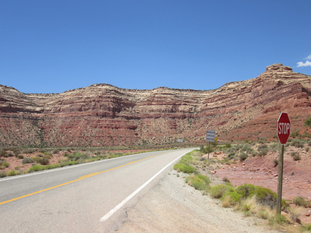 Looking up at the Moki Dugway.  Not visible to the naked eye, a road climbs up this thousand foot cliff.