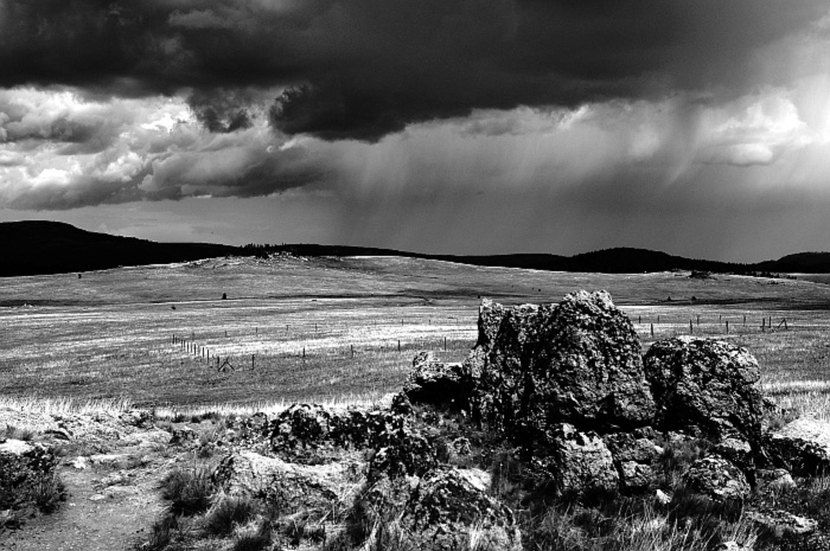 """Still at the """"point of interest,"""" rain clouds approached. The high elevation means that Medicine Mountain often gets its own weather."""