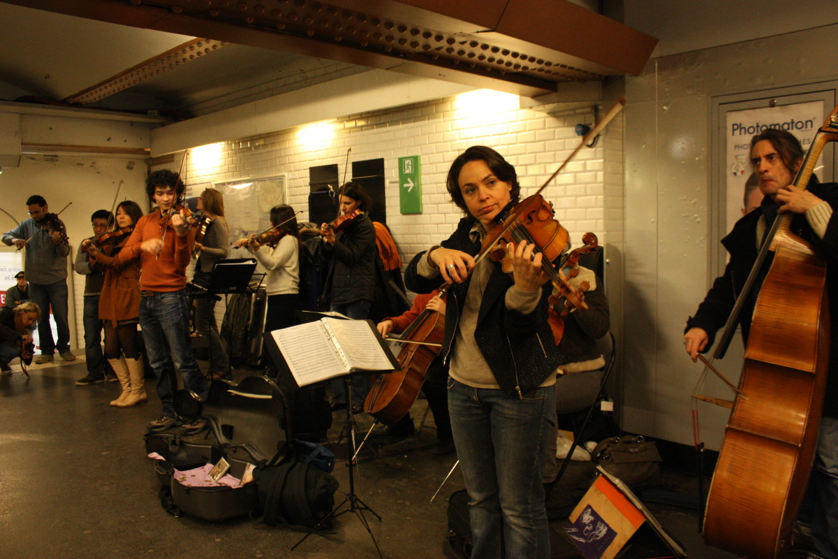 An orchestra playing in the metro station in Paris.