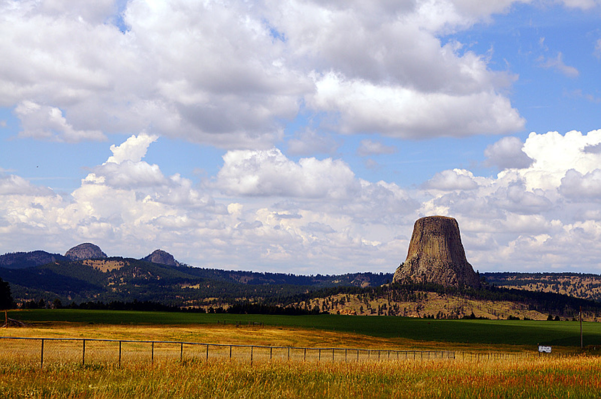 Devil's Tower from afar. The rock almost seems to appear out of nowhere.
