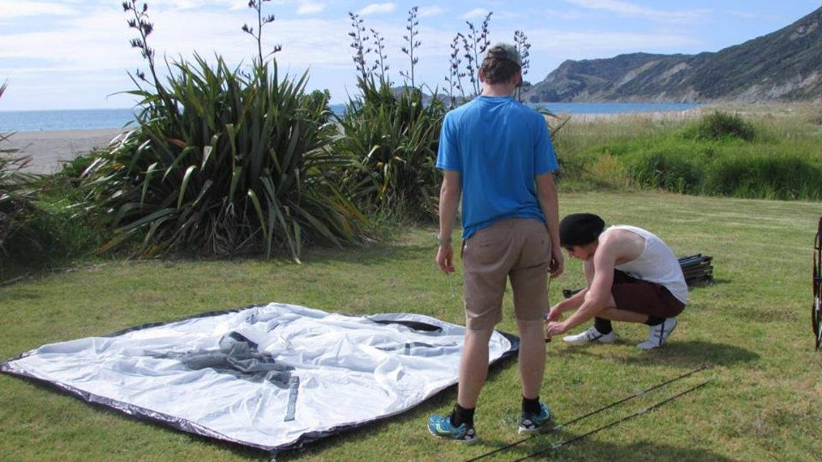 My sons and I freedom camping with tent and van at Tokomaru Bay (Dec 2015)