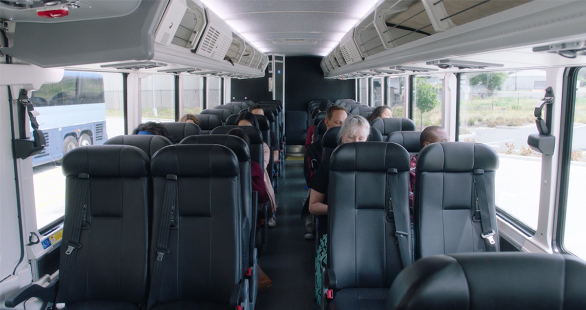 The closer you are to the driver, the farther you are from the smelly bathroom and the less likely you are to encounter problematic passengers.