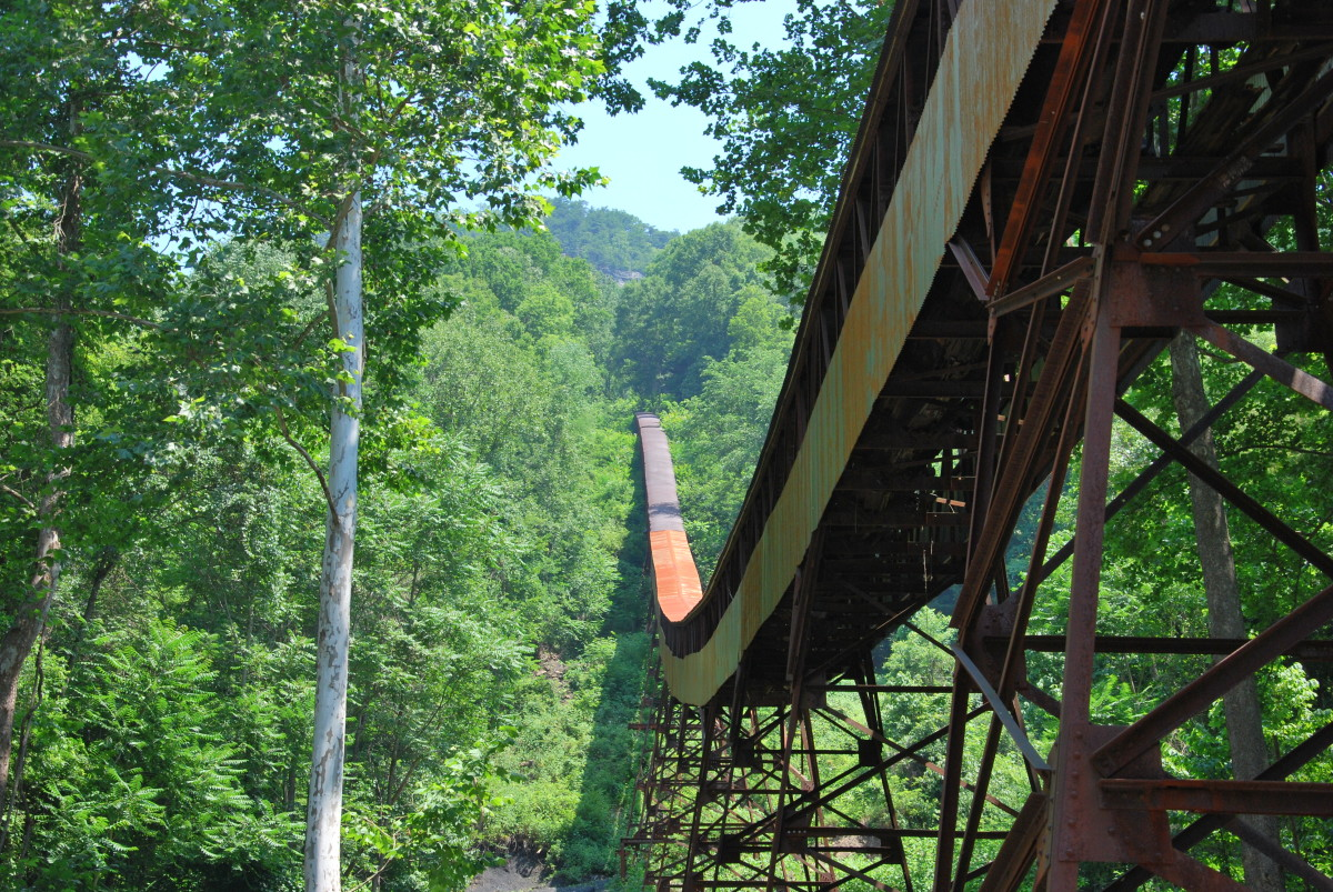 The Conveyor Trail in Nuttallburg takes hikers under the old coal conveyor of the Nuttall mine. Historical artifacts should be left in place and not disturbed along this trail.