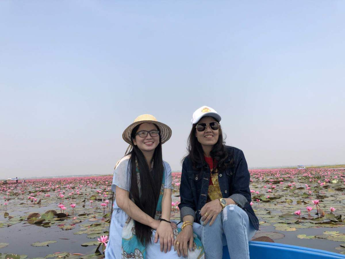 On a boat in the Sea of Red Lotuses. My friend is on the left and wife on the right.