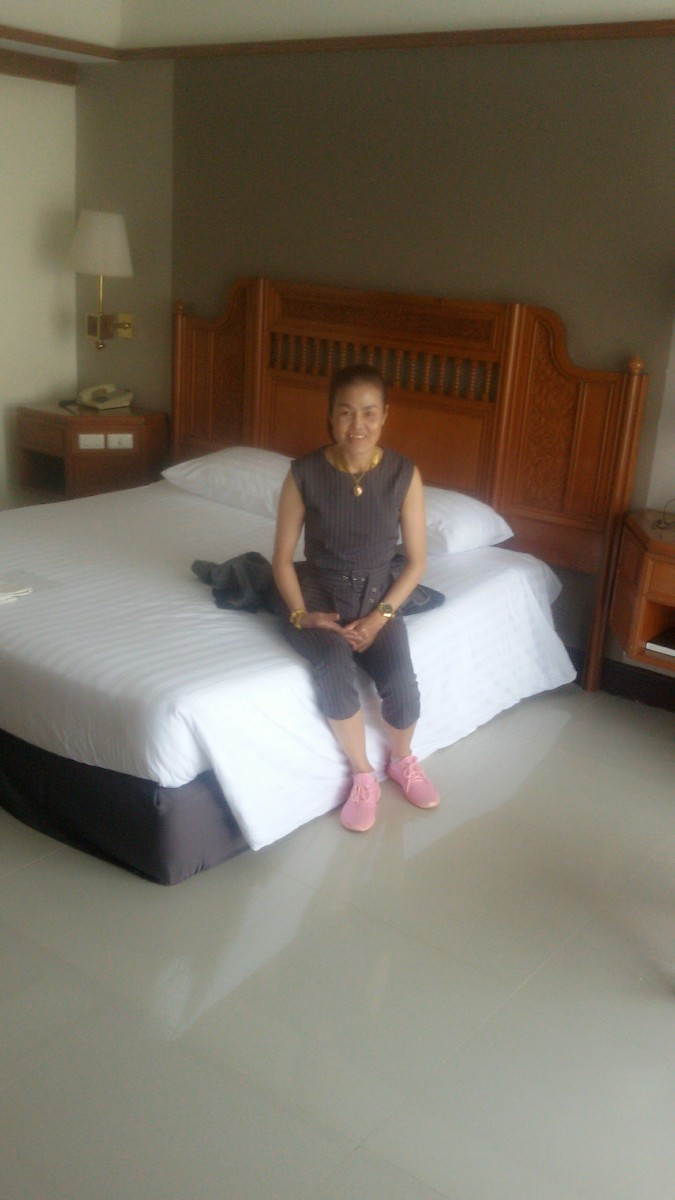 My wife inside our Loei Palace Hotel Room