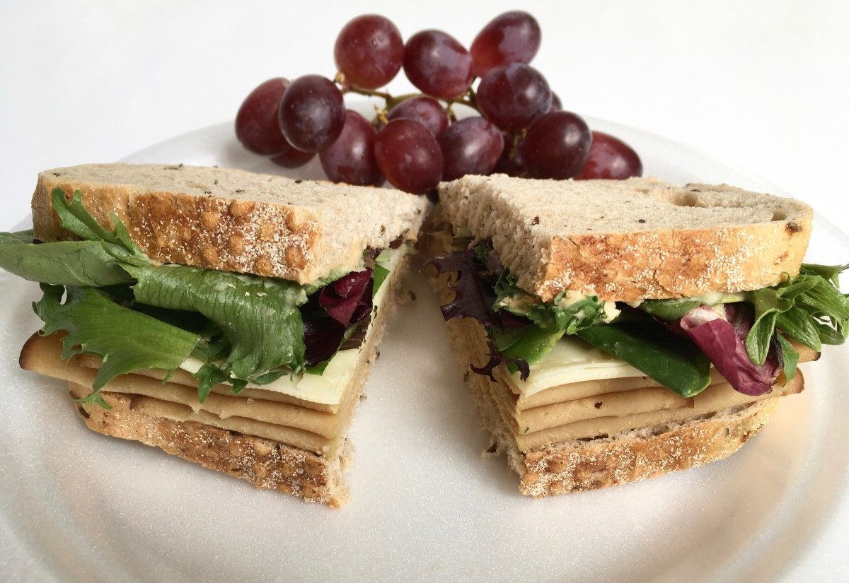 I like bringing sandwiches for a healthy lunch on a road trip because they take little time to make and pack well. Just avoid adding wet condiments or tomatoes to keep them from getting soggy.
