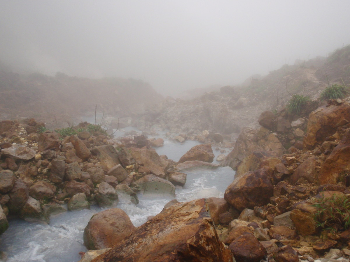 Steam is everywhere as you approach the boiling lake in Dominica. This river lies along the trail.