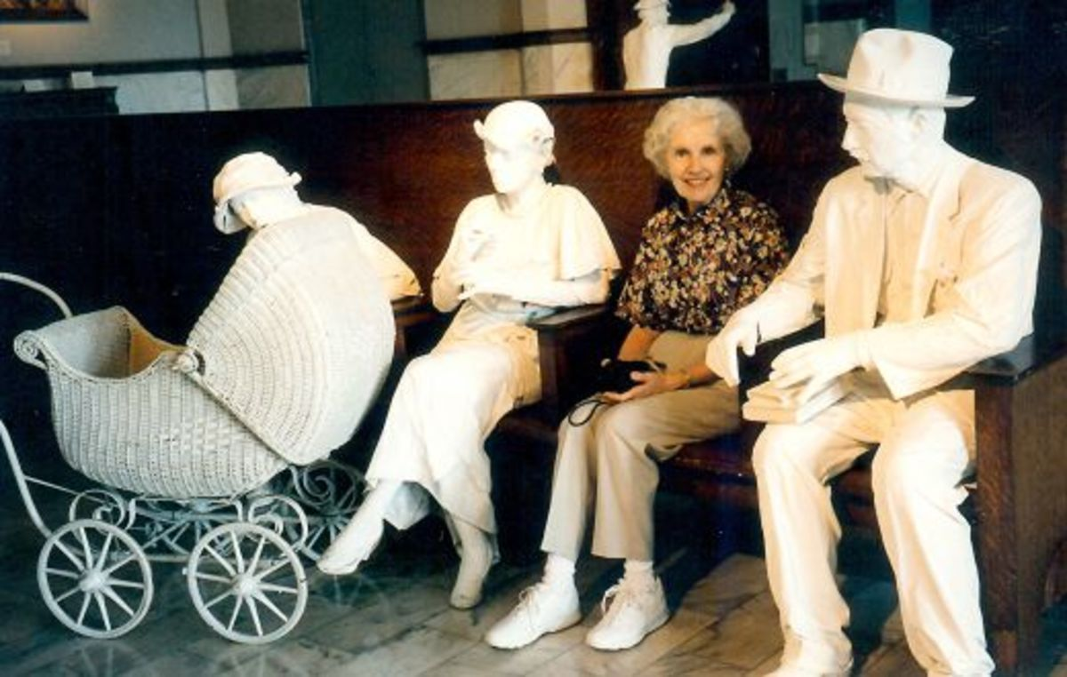 My aunt seated among the life sized figures inside of the Galveston Railroad Museum
