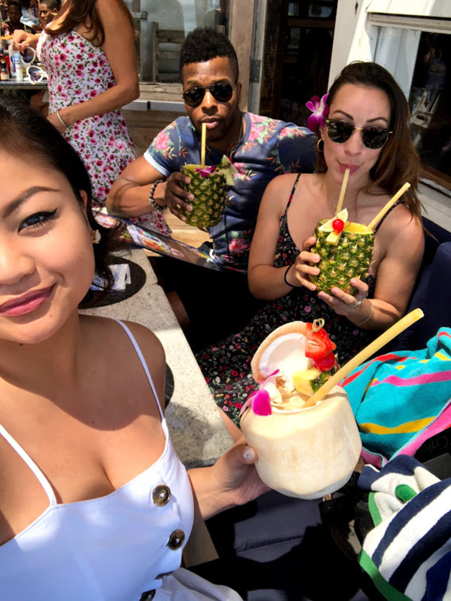 Enjoying our tropical drinks.
