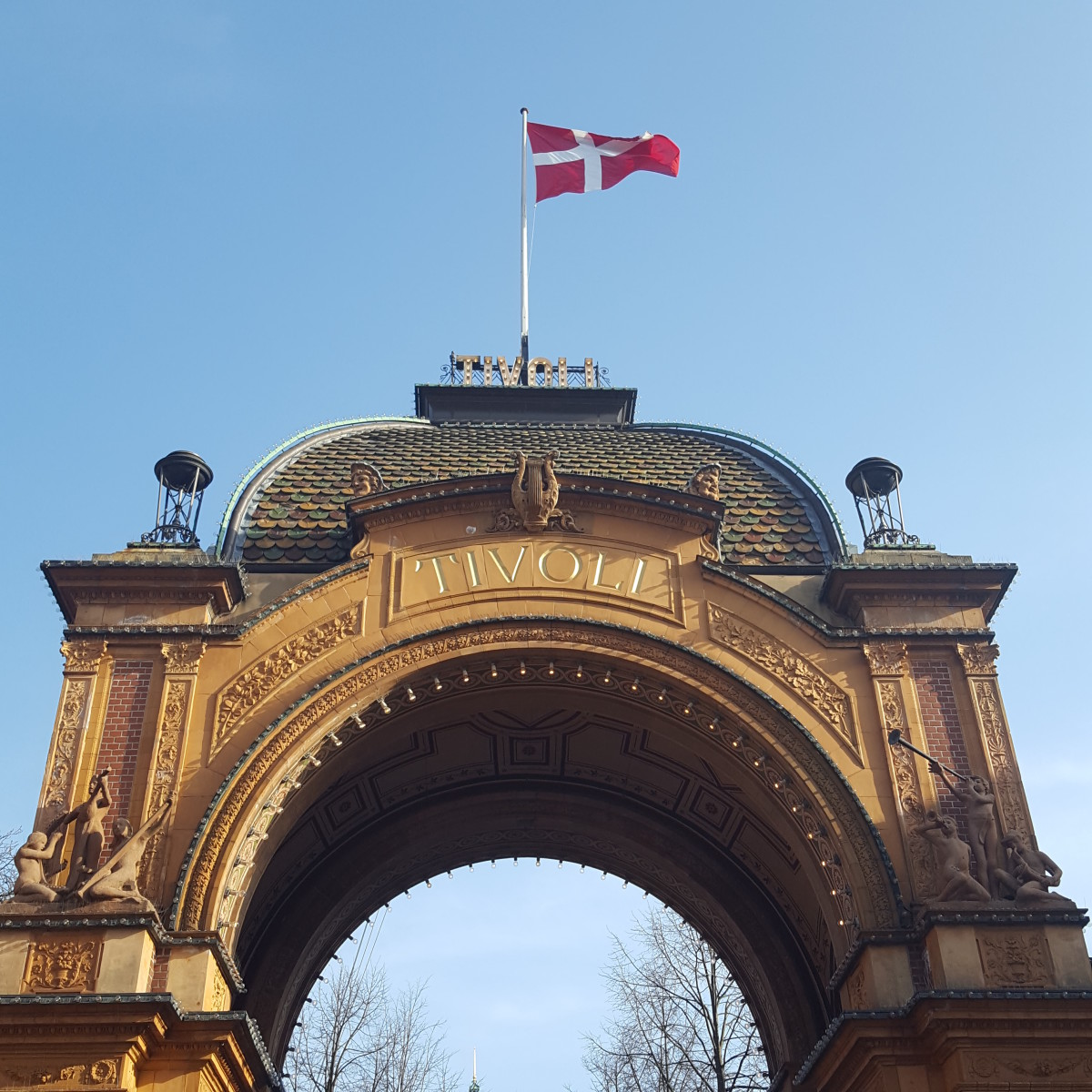 The Danish Flag flies over the entrance to Tivoli Garden.