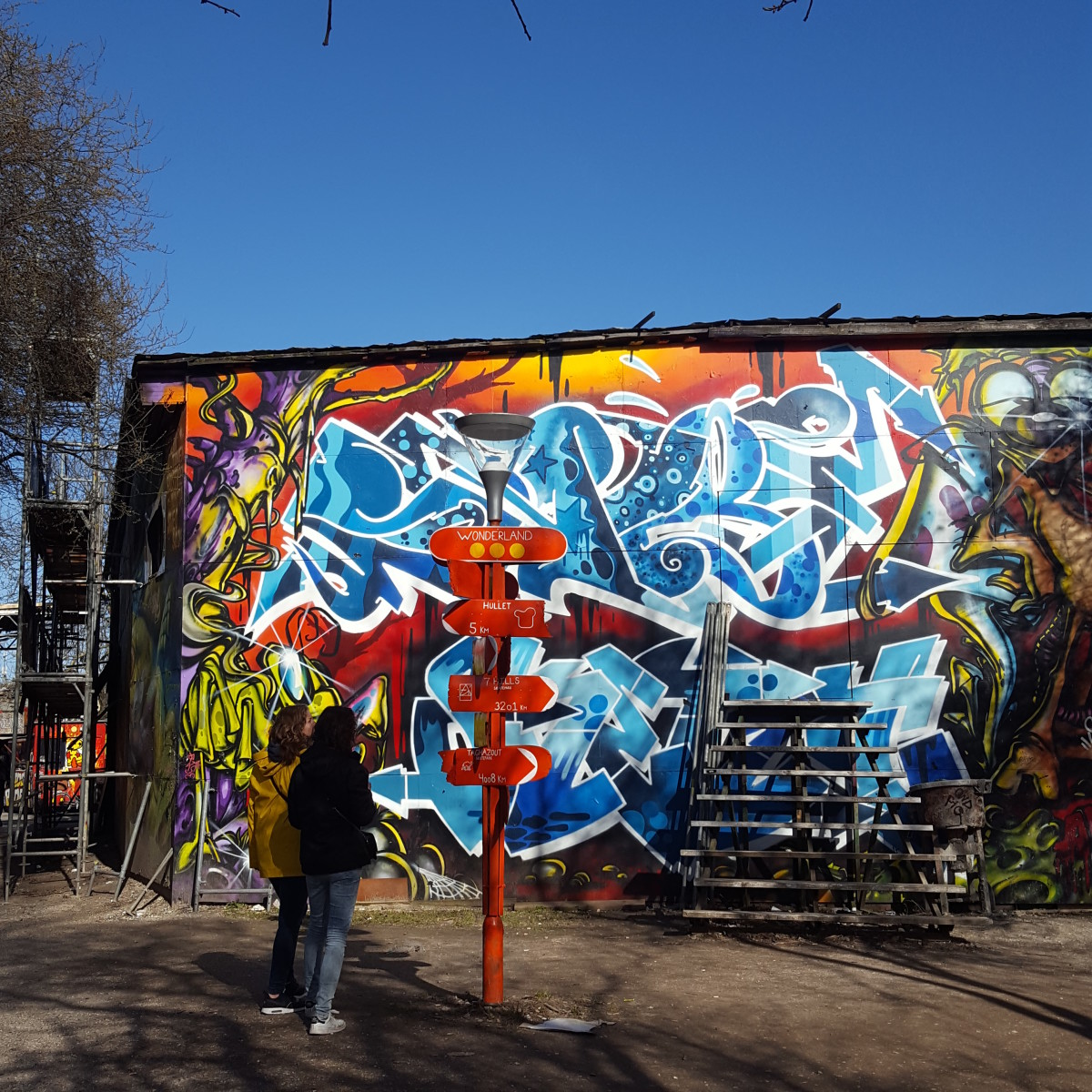 'Wonderland'.  A sign and some graffiti in Christianshavn's Freetown area.