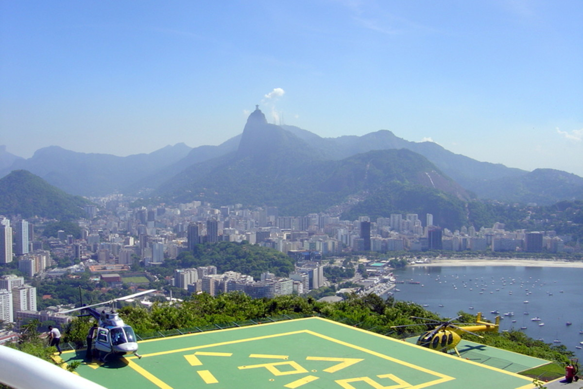 A heliport for sightseeing helicopters overlooks Centro (the downtown area), Botofogo Bay and neighborhood, and Cristo Redentor on Corcovado Mountain (on the far horizon, center).