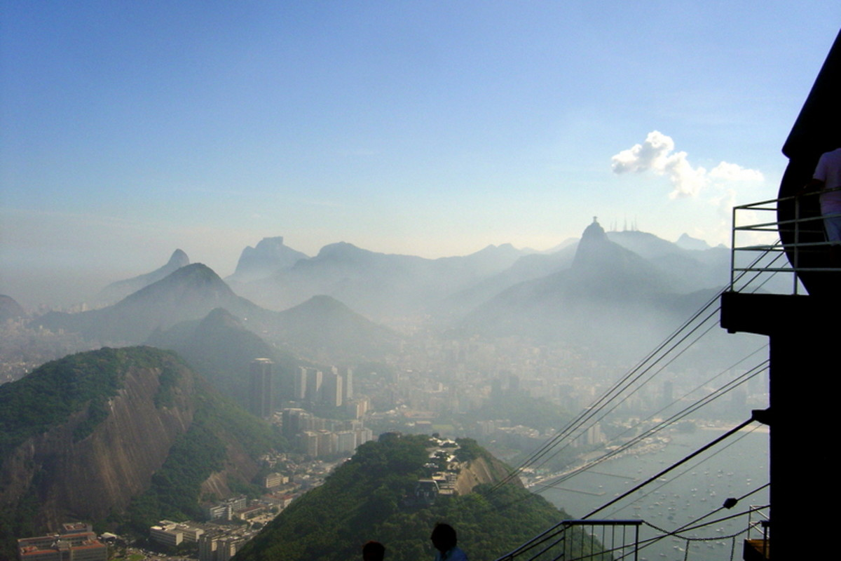 View of Botafogo Neighborhood, Rio from the cable car atop Sugarloaf Mountain. A foggy view of Centro (downtown Rio), Cristo Redentor (Christ the Redeemer) on the horizon at right, and the Botafogo neighborhood.