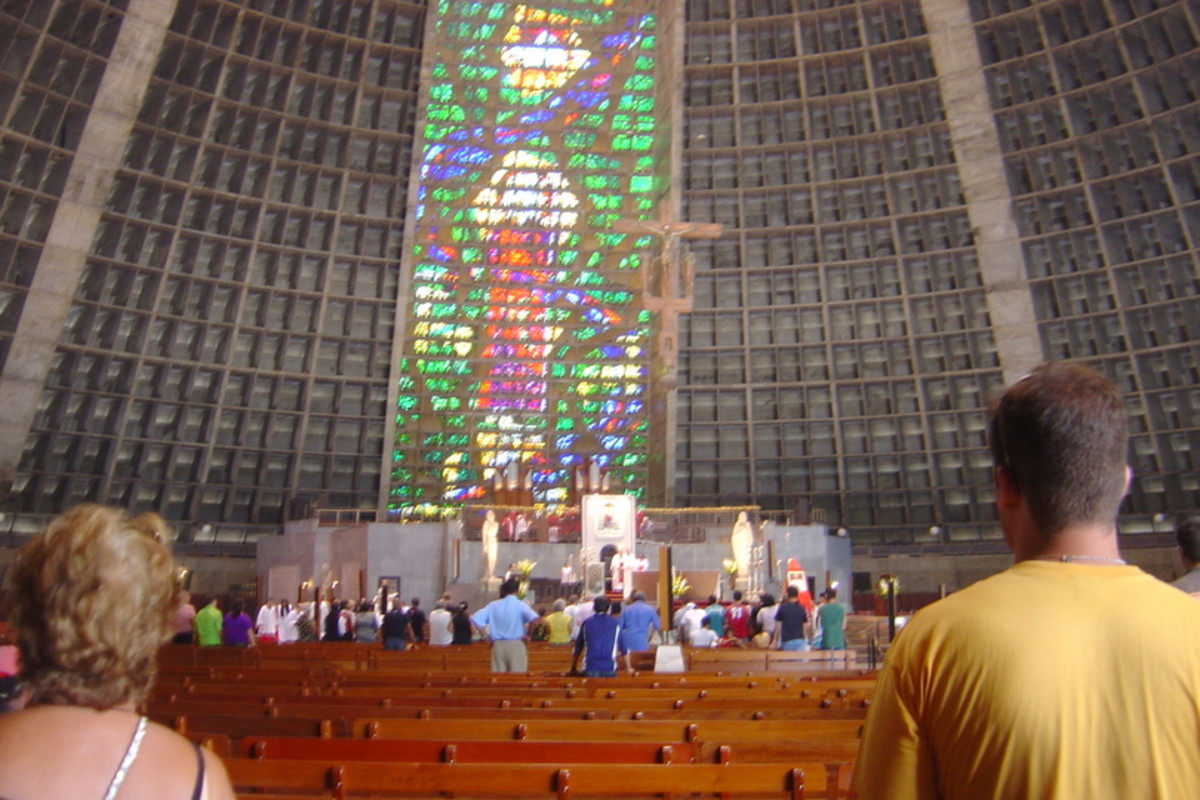 Parishioners and travelers alike worship in the Metropolitan Cathedral of San Sebastian with reverence in the impressive modern space as the Bishop conducts services.