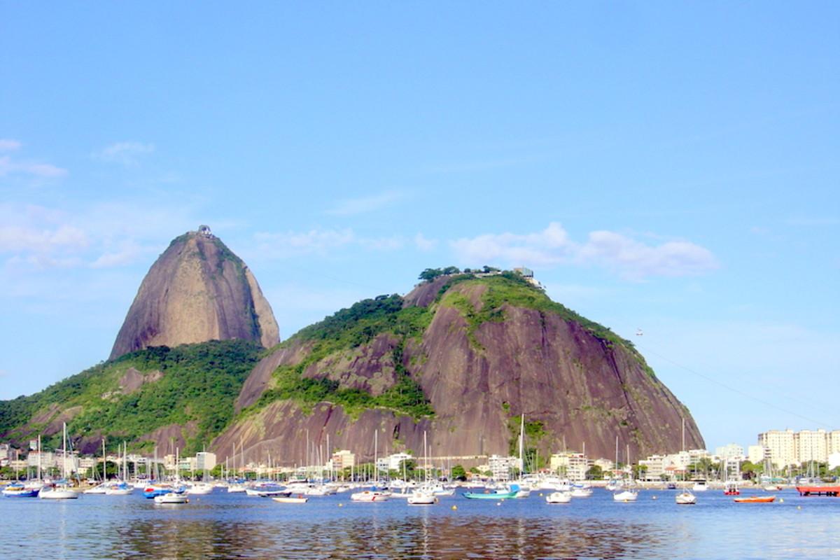 Pão de Açúcar (Sugarloaf Mountain) and Morro da Urca (the Hill of the Cargo Ship), overlooking private pleasure boats harbored in Botafogo Cove of Guanabara Bay.
