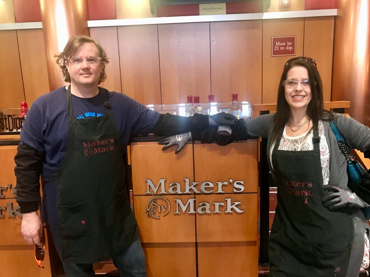 Dipping our own wax seal on our bottle from Maker's Mark