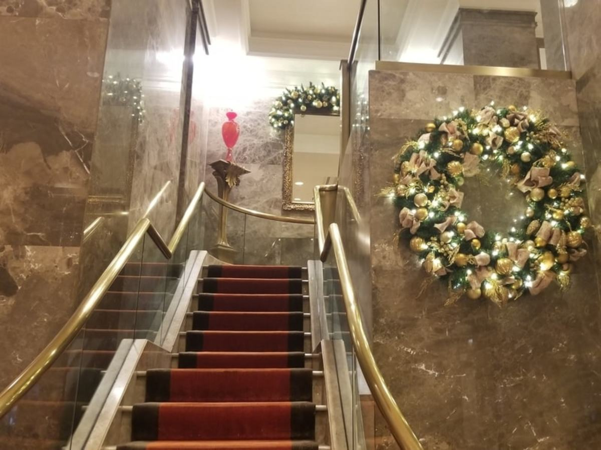 The beautiful stairway leading from the first floor lobby and lounge area to additional lounge space on the second floor.