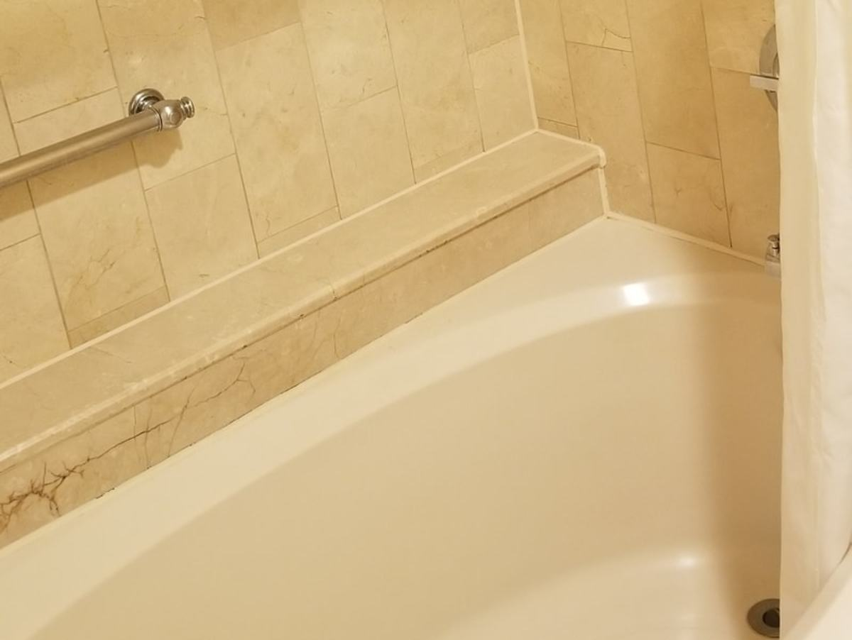 Notice the amazing tile work and just how spotless the area around this large bathtub is. These up close pictures is usually where you can see the dirt and grime. It's spotless.
