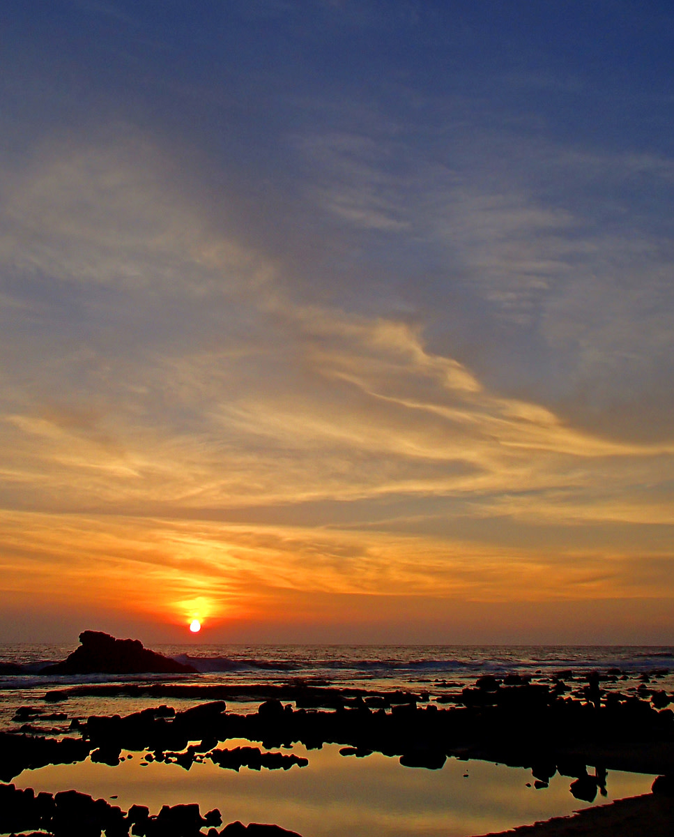 Sunset over the tide pools at Old Kona Airport Beach.