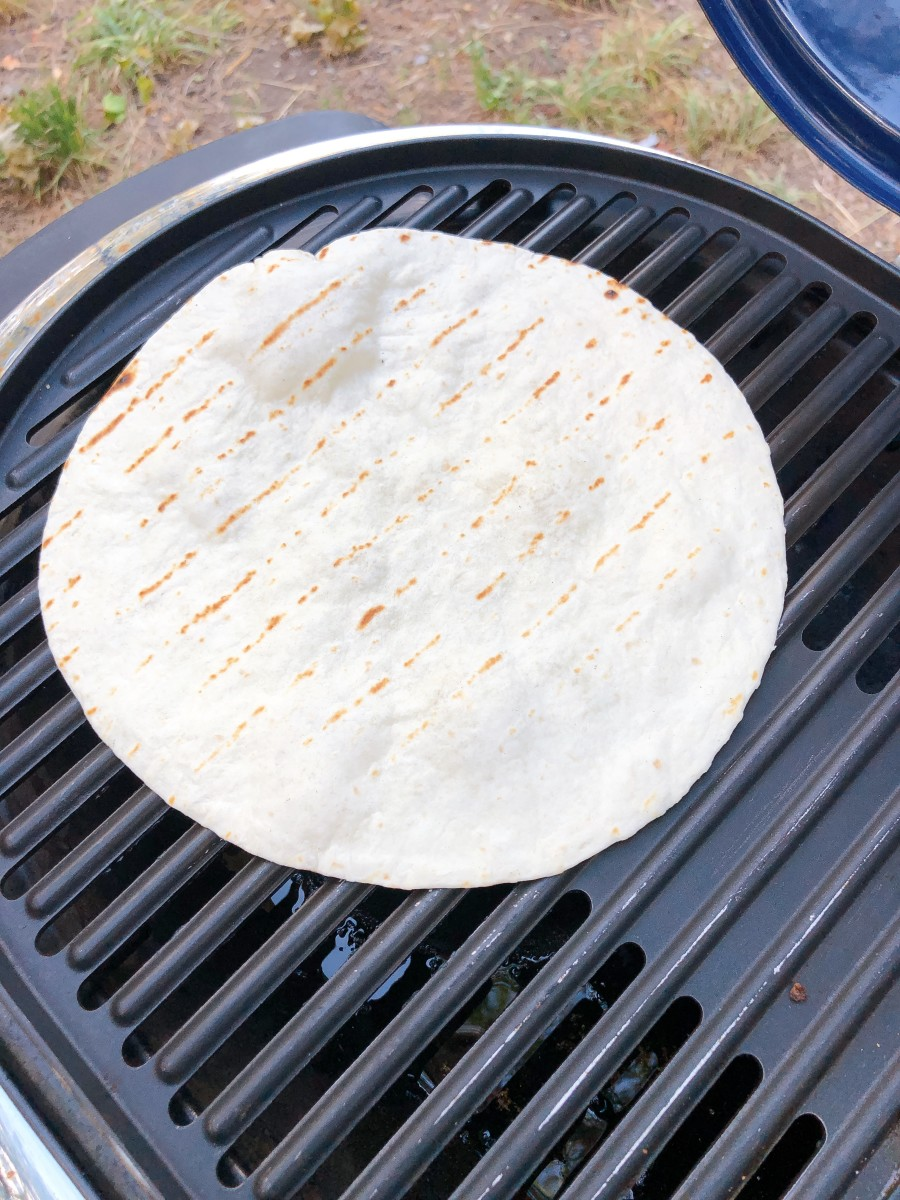 Warming up the tortilla wrap on the grill.