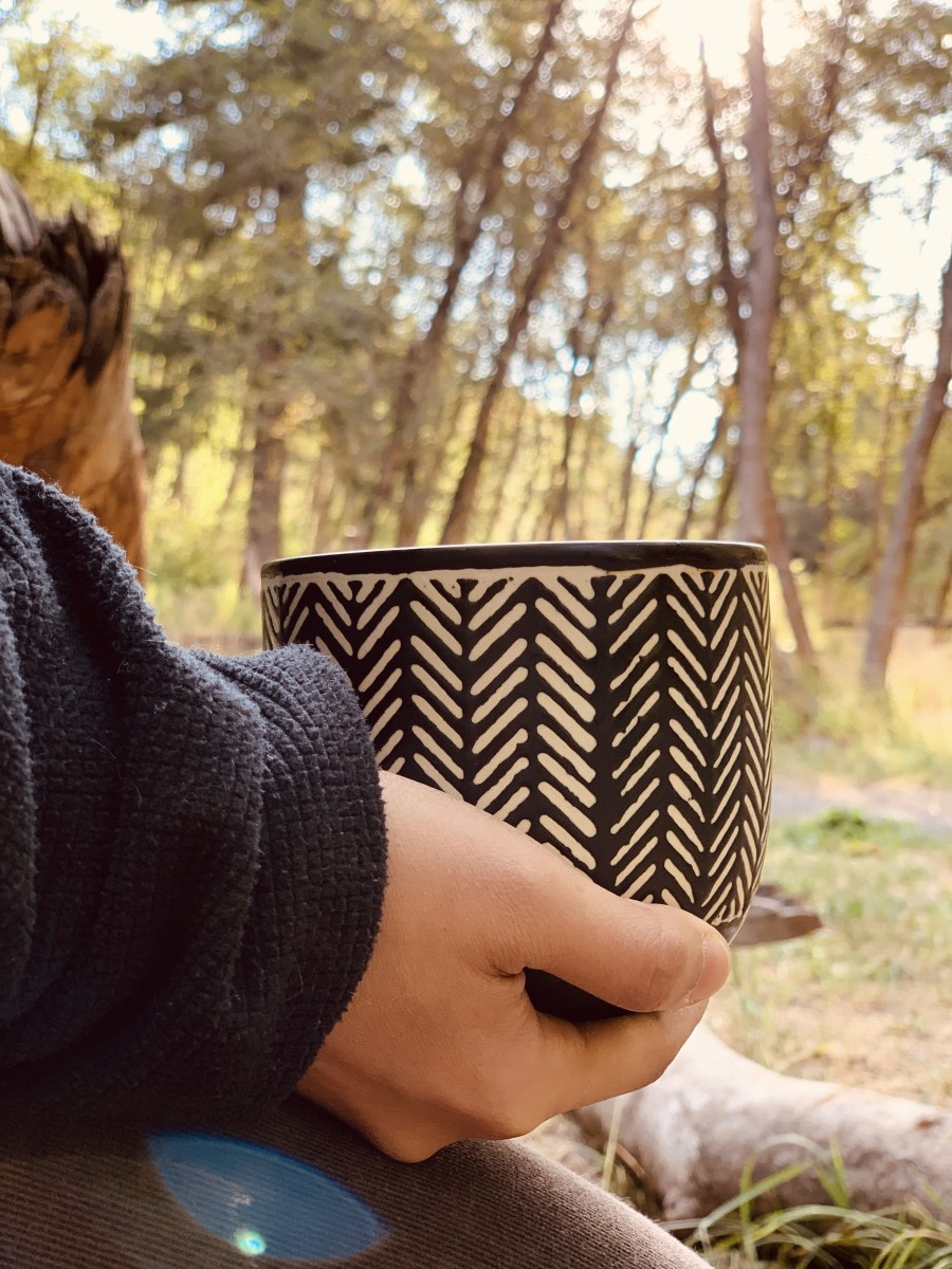 Sipping the coffee whilst listening to the morning sounds.